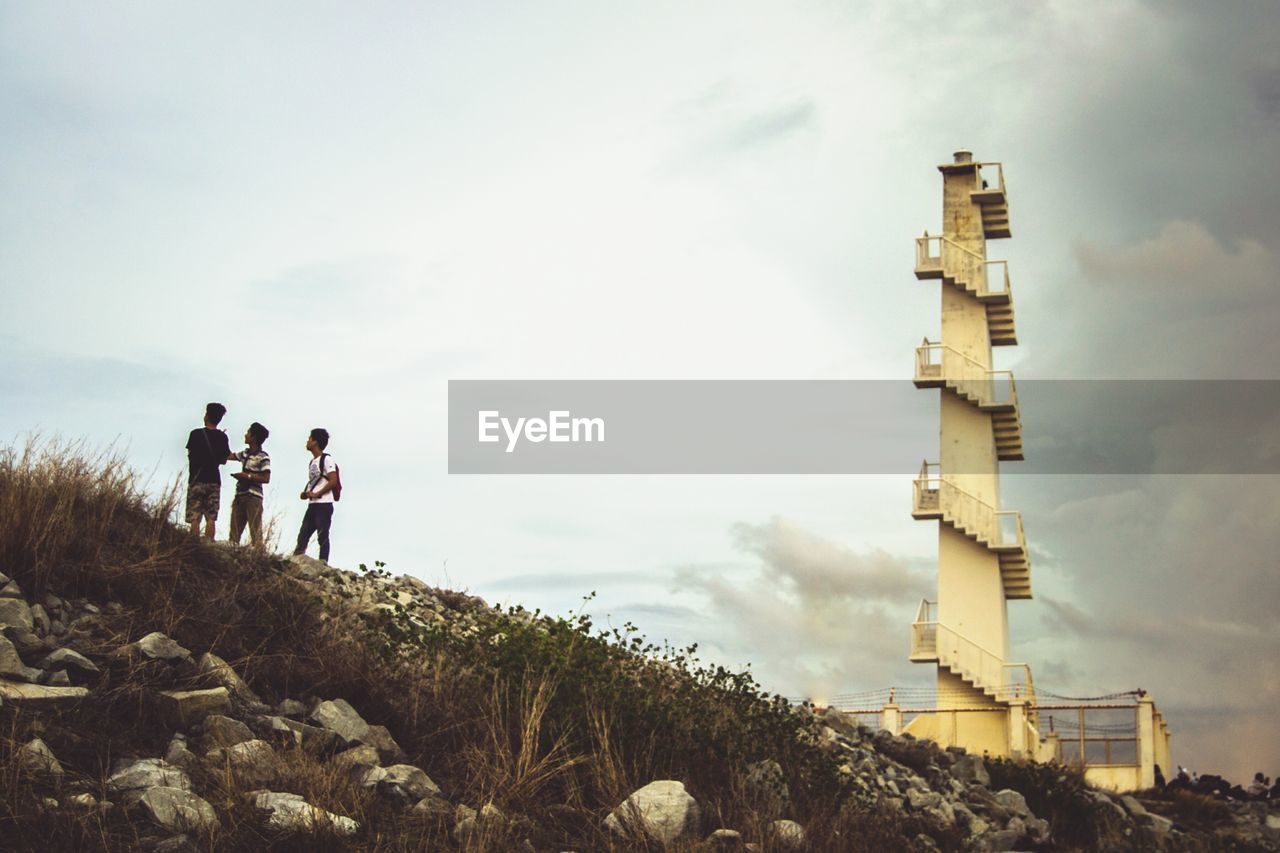 sky, real people, cloud - sky, nature, lifestyles, architecture, leisure activity, men, people, day, group of people, built structure, standing, togetherness, outdoors, women, adult, travel, low angle view
