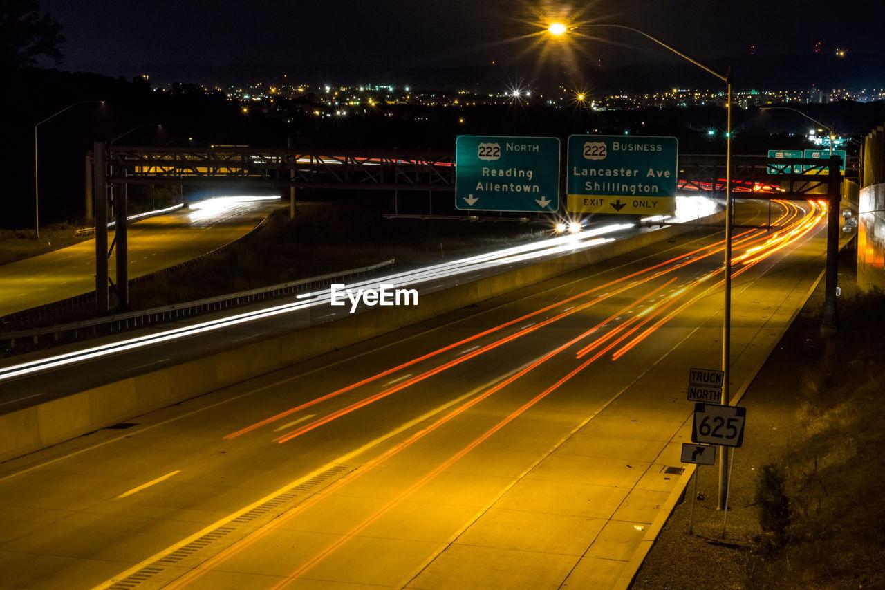 light trail, illuminated, speed, night, long exposure, motion, transportation, blurred motion, road, traffic, no people, high street, street light, outdoors, yellow, city