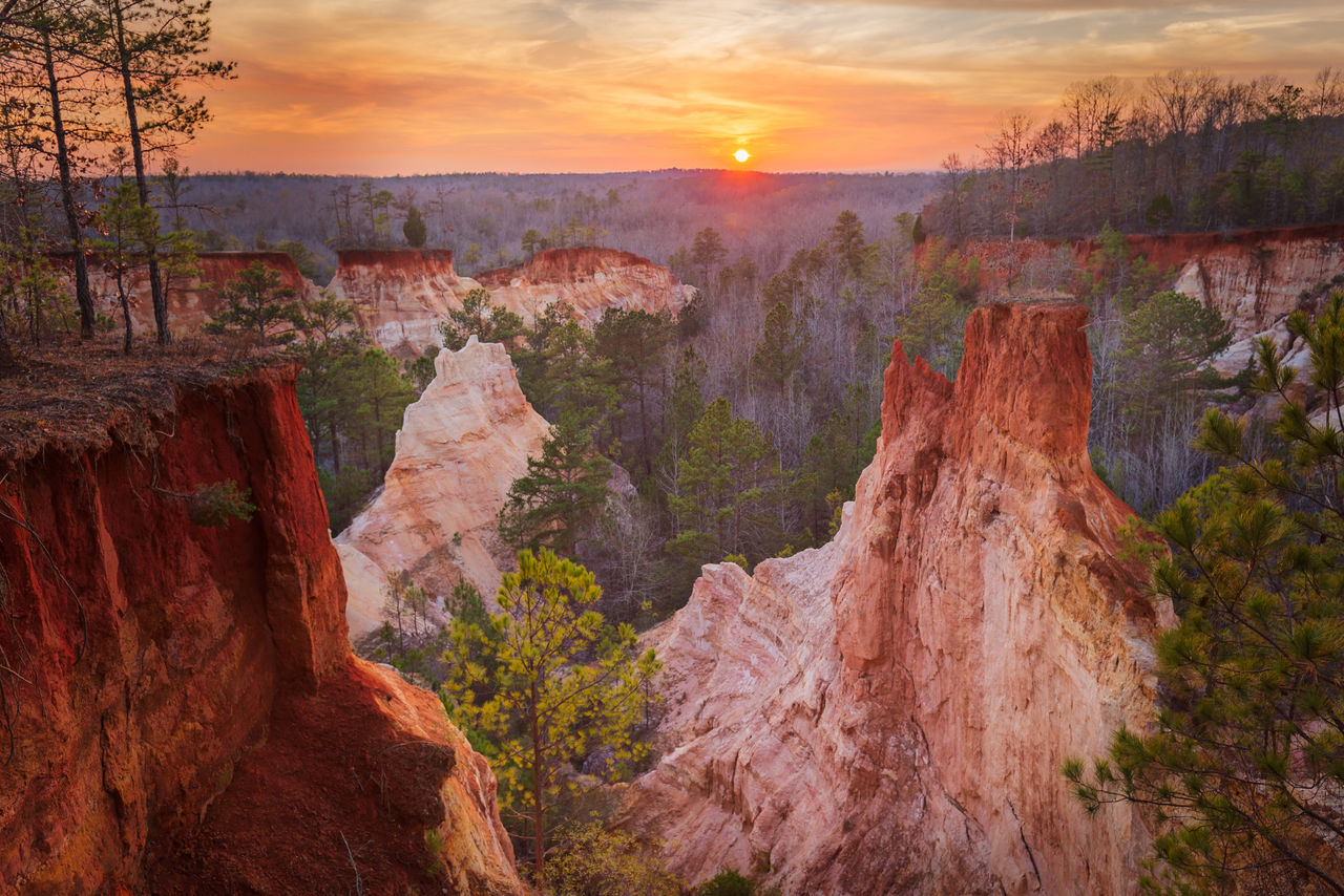 beauty in nature, scenics - nature, rock formation, sunset, rock, rock - object, tranquility, nature, tranquil scene, sky, travel destinations, solid, non-urban scene, no people, physical geography, environment, cloud - sky, travel, geology, mountain, outdoors, eroded, formation