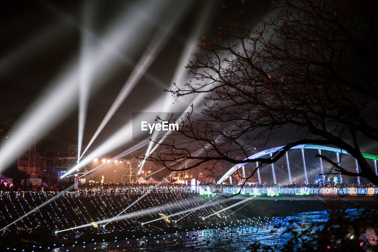 illuminated, night, architecture, built structure, building exterior, bare tree, city, outdoors, sky, stadium, no people