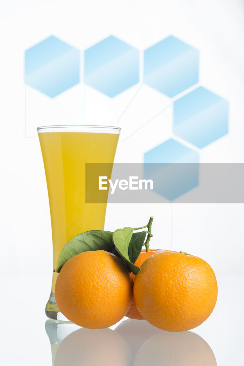 food and drink, food, healthy eating, fruit, citrus fruit, refreshment, wellbeing, drink, freshness, still life, orange color, indoors, orange, orange - fruit, glass, no people, household equipment, drinking glass, close-up, table, non-alcoholic beverage