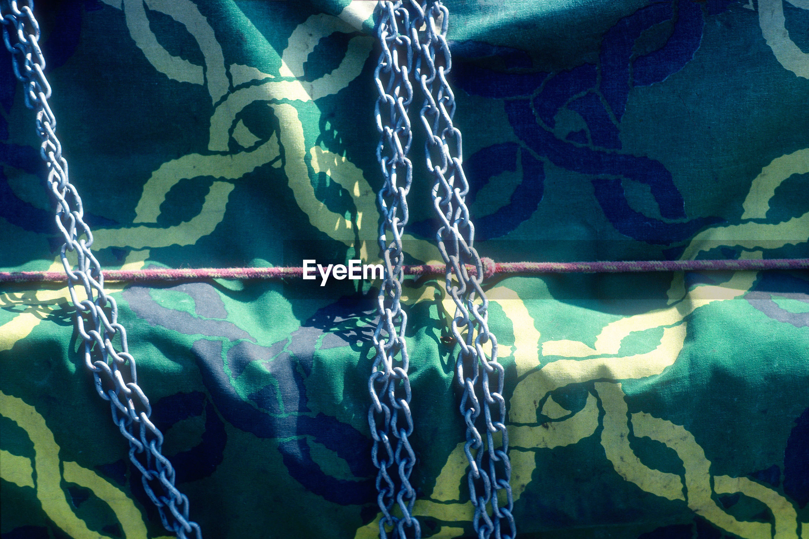 Close-up of chains on fabric