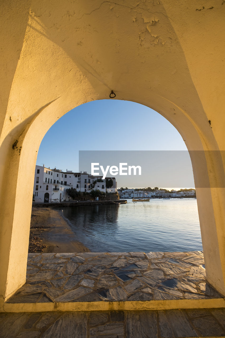 water, architecture, arch, built structure, sky, nature, day, no people, sea, transportation, building exterior, outdoors, clear sky, history, the past, building, yellow, nautical vessel, travel destinations, arched