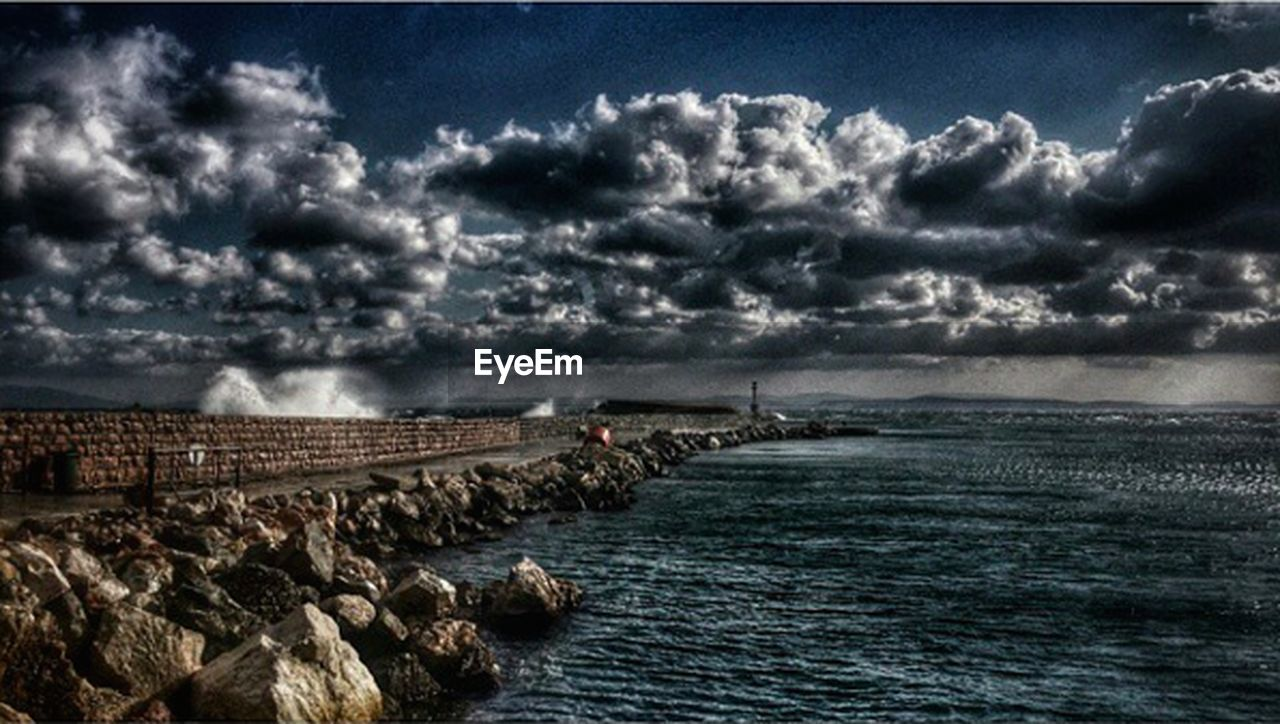 cloud - sky, sky, water, nature, sea, beauty in nature, outdoors, no people, scenics, tranquility, day, storm cloud, horizon over water, architecture