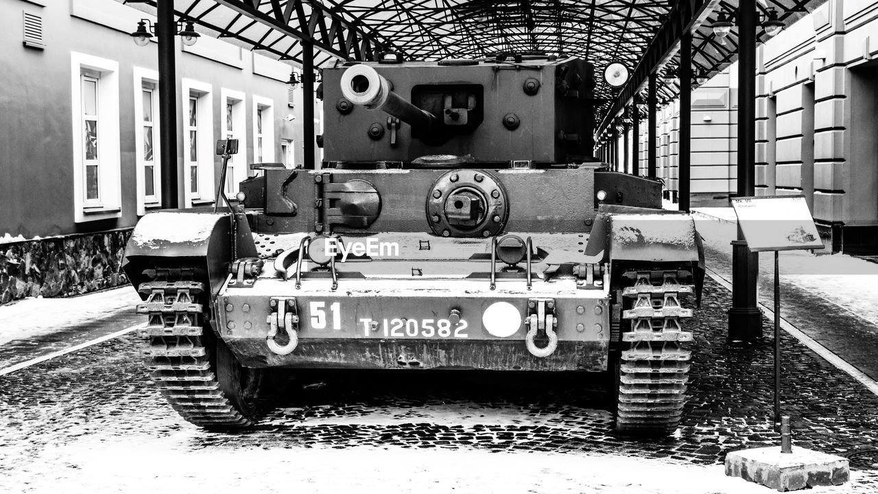 transportation, mode of transportation, no people, land vehicle, architecture, day, built structure, outdoors, field, city, technology, nature, communication, land, decline, abandoned, old, armored tank, building exterior