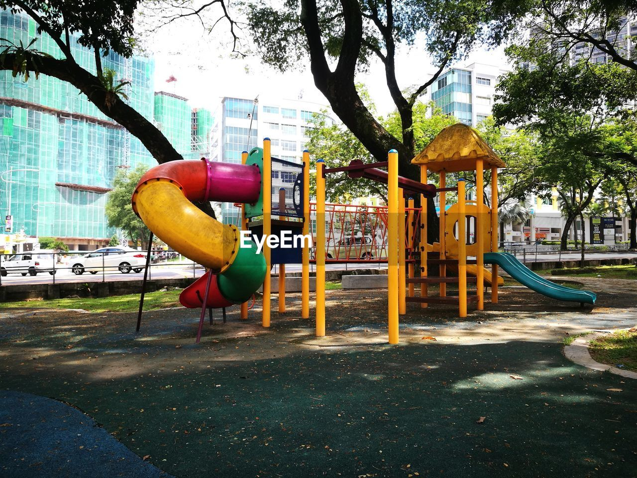 playground, tree, outdoor play equipment, architecture, no people, park - man made space, outdoors, built structure, day, building exterior, city, sky