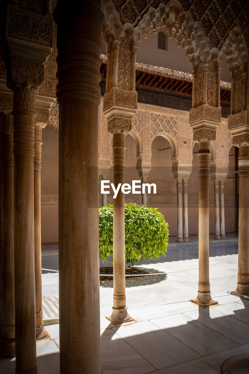 architectural column, architecture, built structure, history, the past, arch, travel destinations, arcade, building, day, no people, nature, tourism, building exterior, sunlight, architectural feature, corridor, colonnade, travel, outdoors, courtyard, ornate, ancient civilization, tiled floor