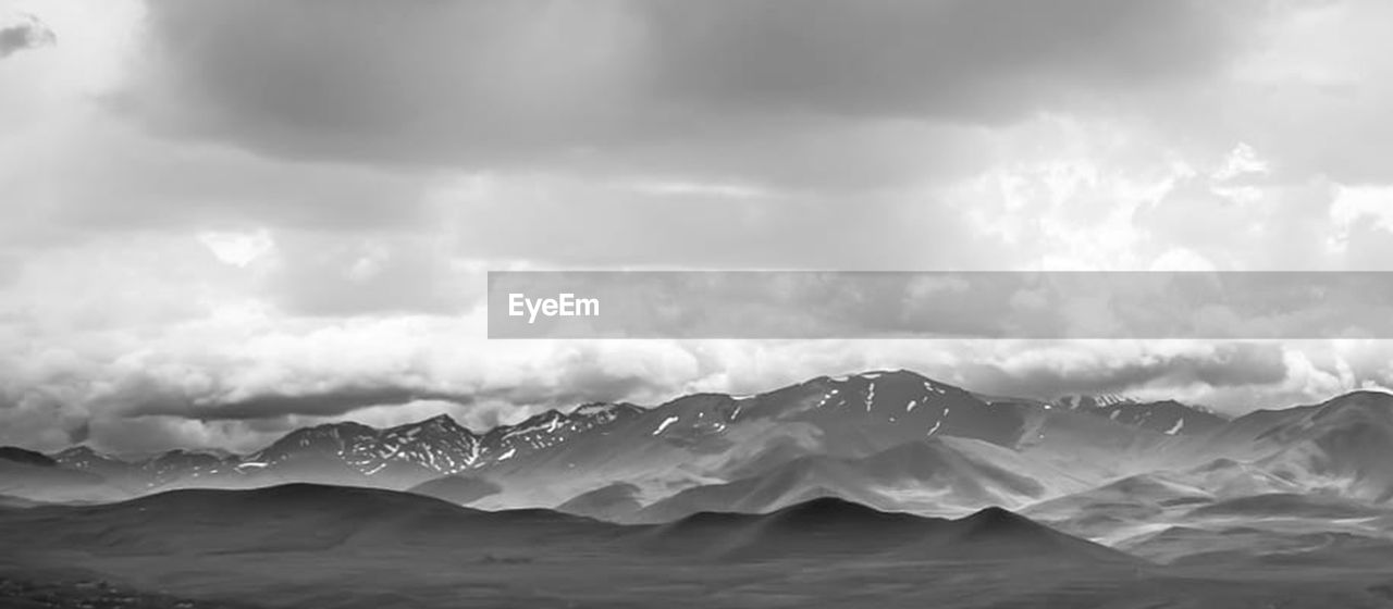 cloud - sky, sky, mountain, mountain range, scenics - nature, beauty in nature, environment, nature, tranquility, storm, no people, tranquil scene, landscape, overcast, outdoors, day, copy space, remote, water, ominous