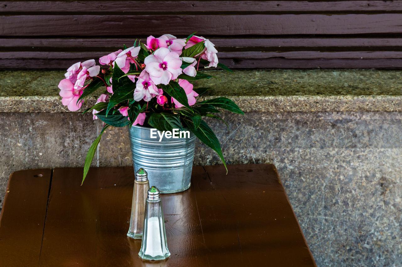 Flower pot on wooden table
