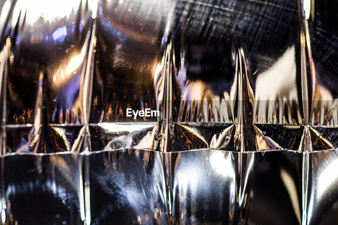 close-up, indoors, no people, glass - material, selective focus, reflection, full frame, backgrounds, shiny, large group of objects, food and drink, metal, illuminated, still life, side by side, lighting equipment, nature, glass, transparent, silver colored