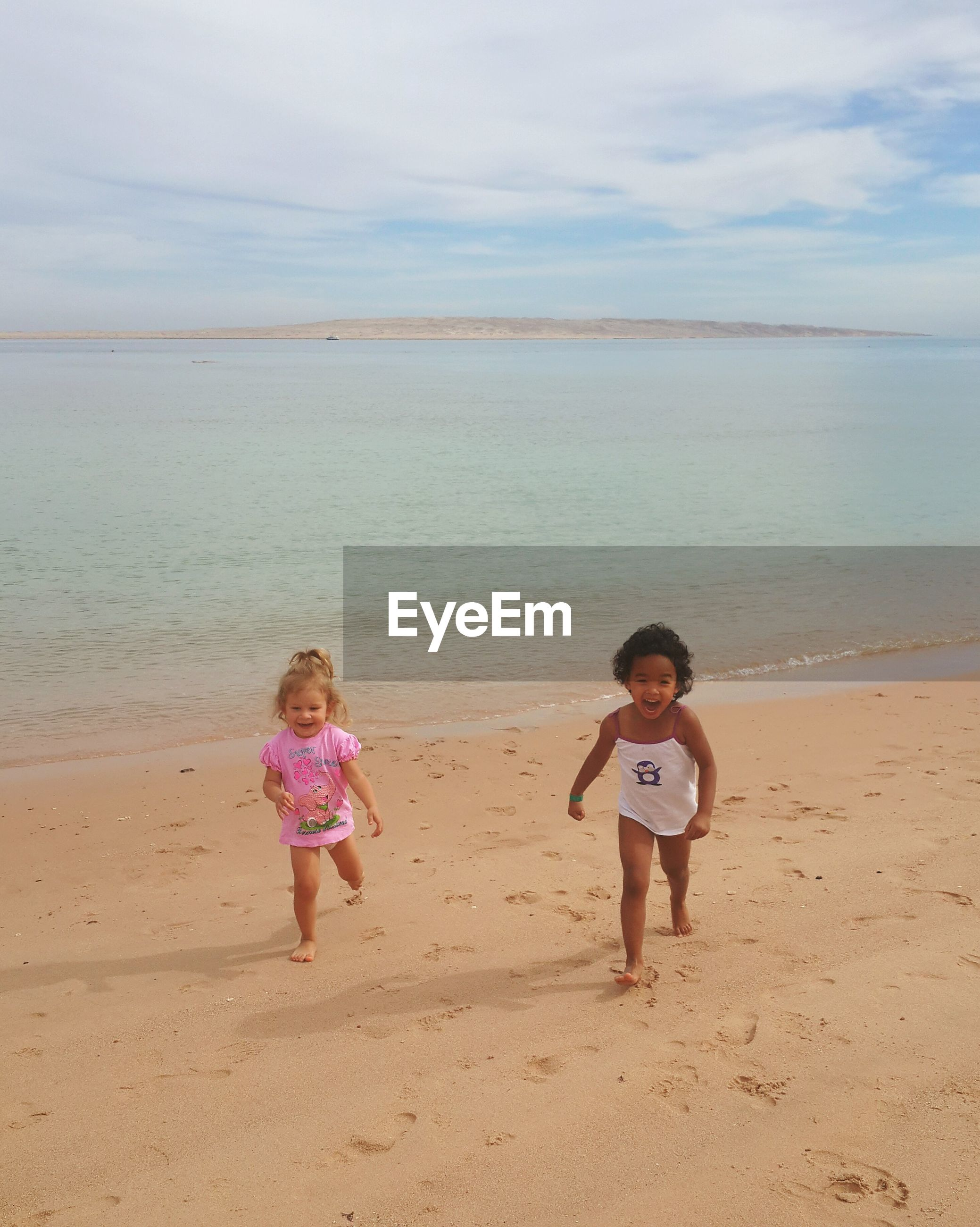 childhood, beach, elementary age, person, boys, girls, full length, lifestyles, leisure activity, togetherness, sand, casual clothing, bonding, shore, family, sea, innocence, love, sibling