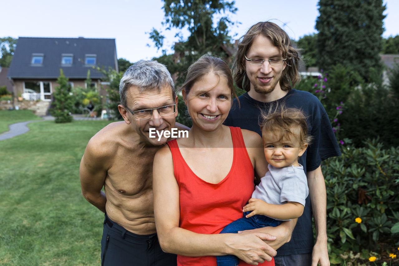 Happy Family In Yard