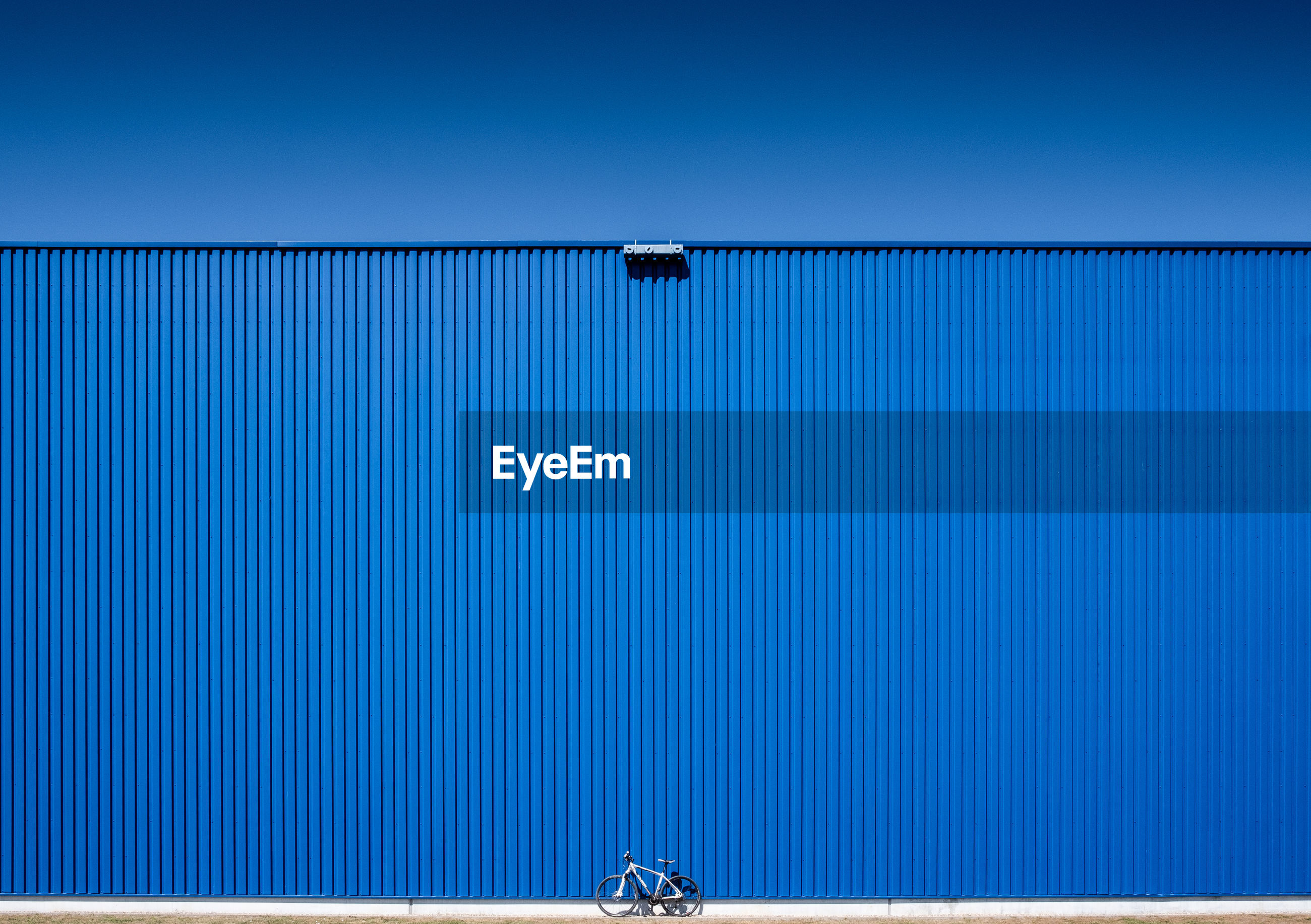 Low angle view of blue container against clear sky