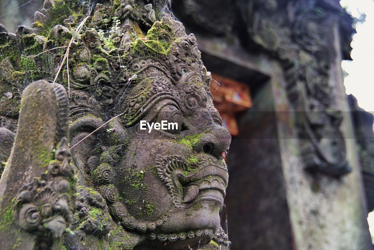 Close-up of old sculpture at pura tirta empul temple