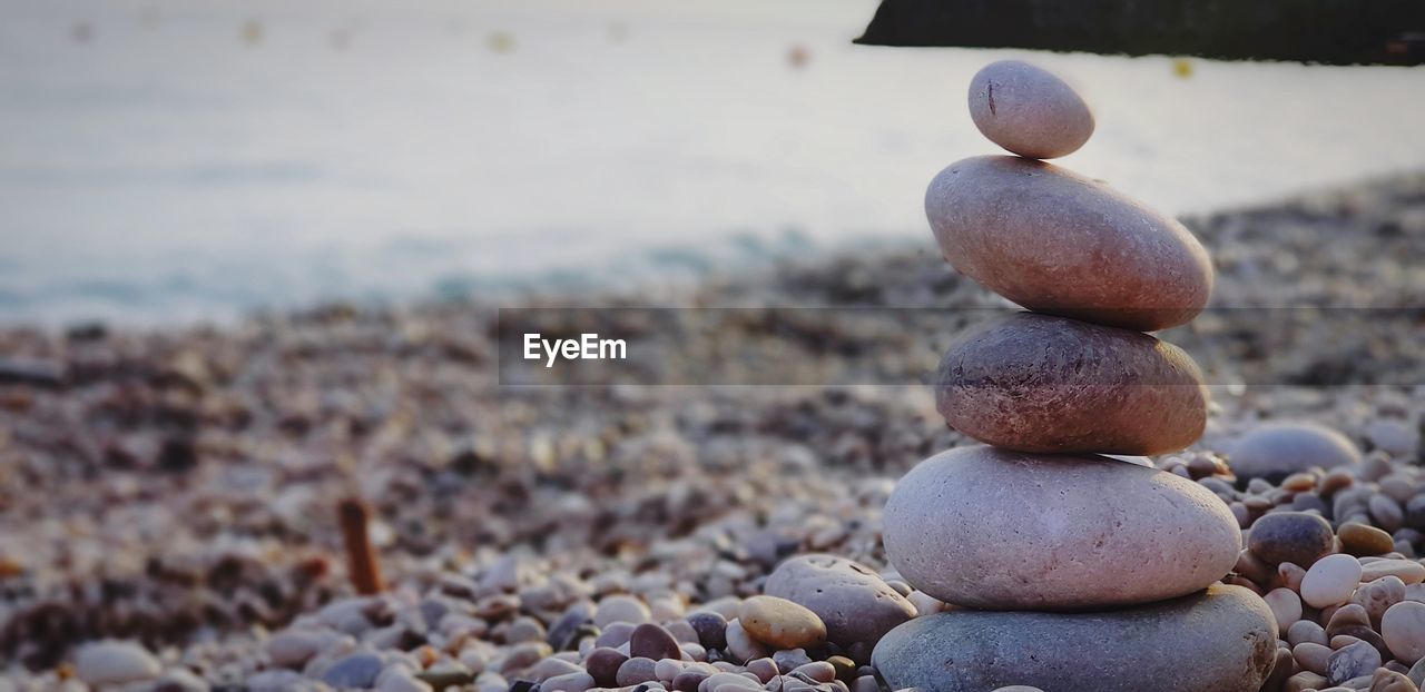 rock, pebble, stone - object, solid, focus on foreground, beach, land, rock - object, no people, stack, nature, day, zen-like, close-up, stone, balance, large group of objects, outdoors, tranquility, beauty in nature