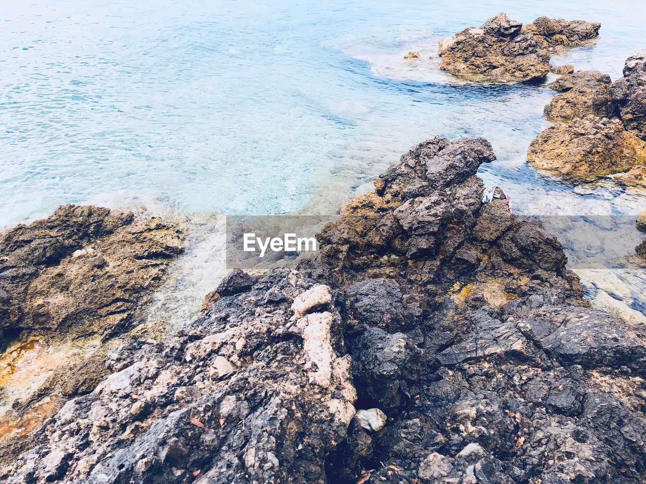 rock, solid, water, rock - object, sea, beauty in nature, land, rock formation, beach, tranquility, nature, day, no people, high angle view, tranquil scene, scenics - nature, outdoors, idyllic, non-urban scene, rocky coastline, eroded