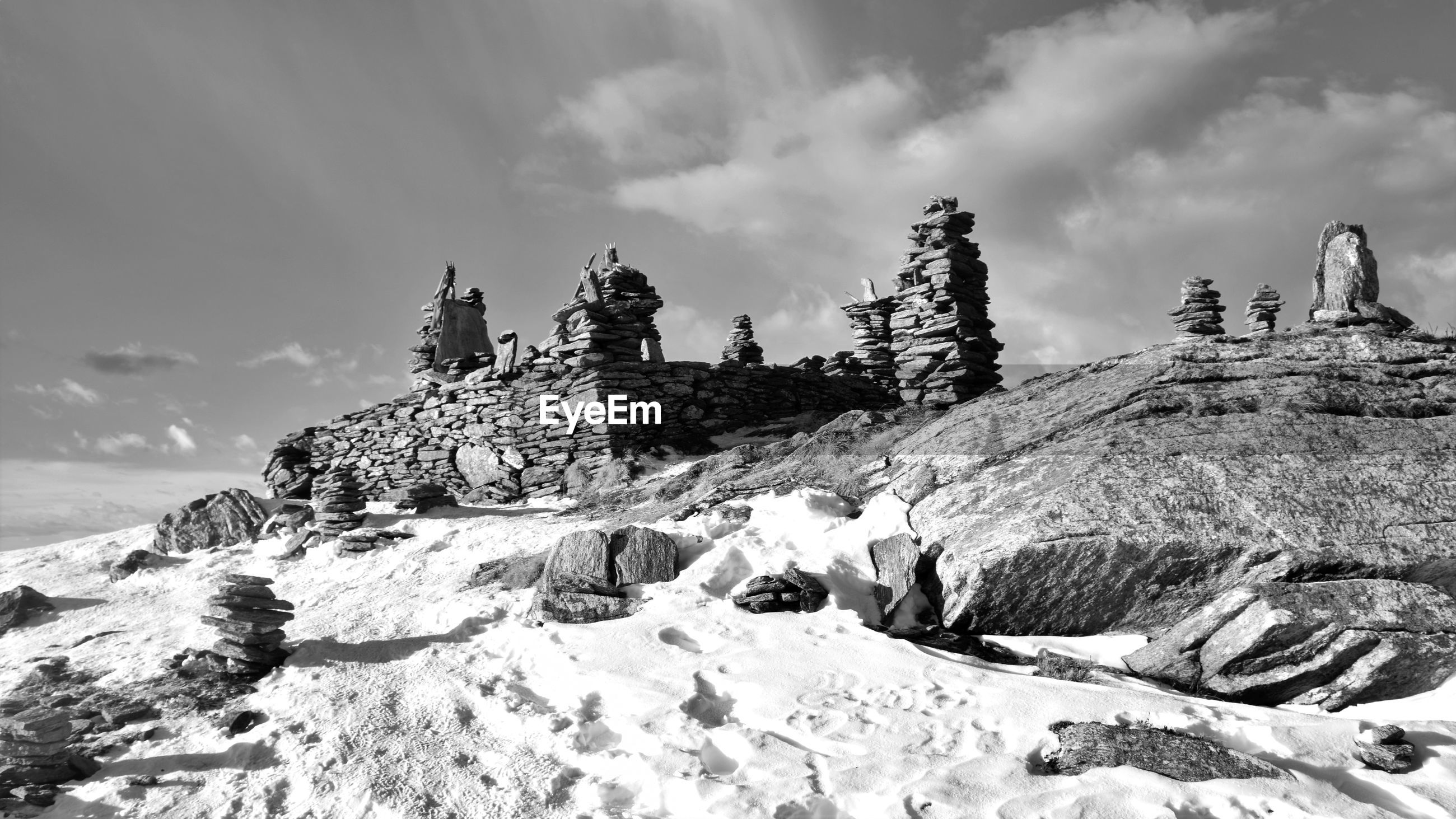 PANORAMIC VIEW OF ROCKS ON SNOW COVERED LAND