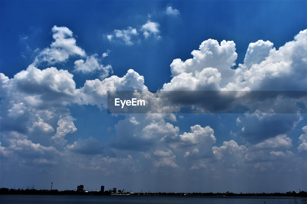 cloud - sky, sky, beauty in nature, scenics - nature, tranquility, nature, tranquil scene, day, water, no people, outdoors, non-urban scene, waterfront, environment, idyllic, landscape, low angle view, distant