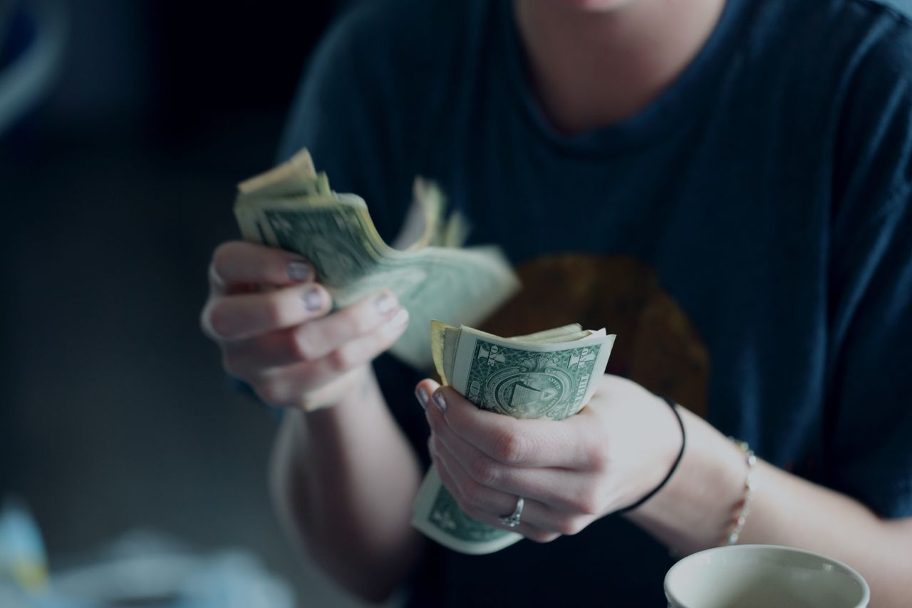 Midsection of woman counting currency