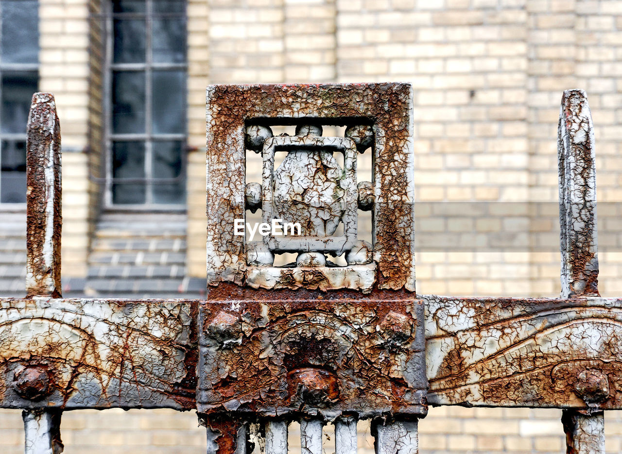 built structure, architecture, day, building exterior, focus on foreground, wall - building feature, no people, weathered, rusty, old, outdoors, wall, metal, brick wall, building, brick, damaged, abandoned, connection, deterioration