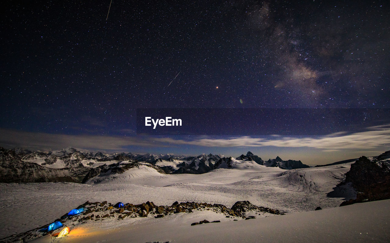night, star - space, scenics - nature, snow, space, sky, beauty in nature, astronomy, cold temperature, winter, tranquil scene, tranquility, no people, nature, galaxy, environment, mountain, idyllic, landscape, snowcapped mountain