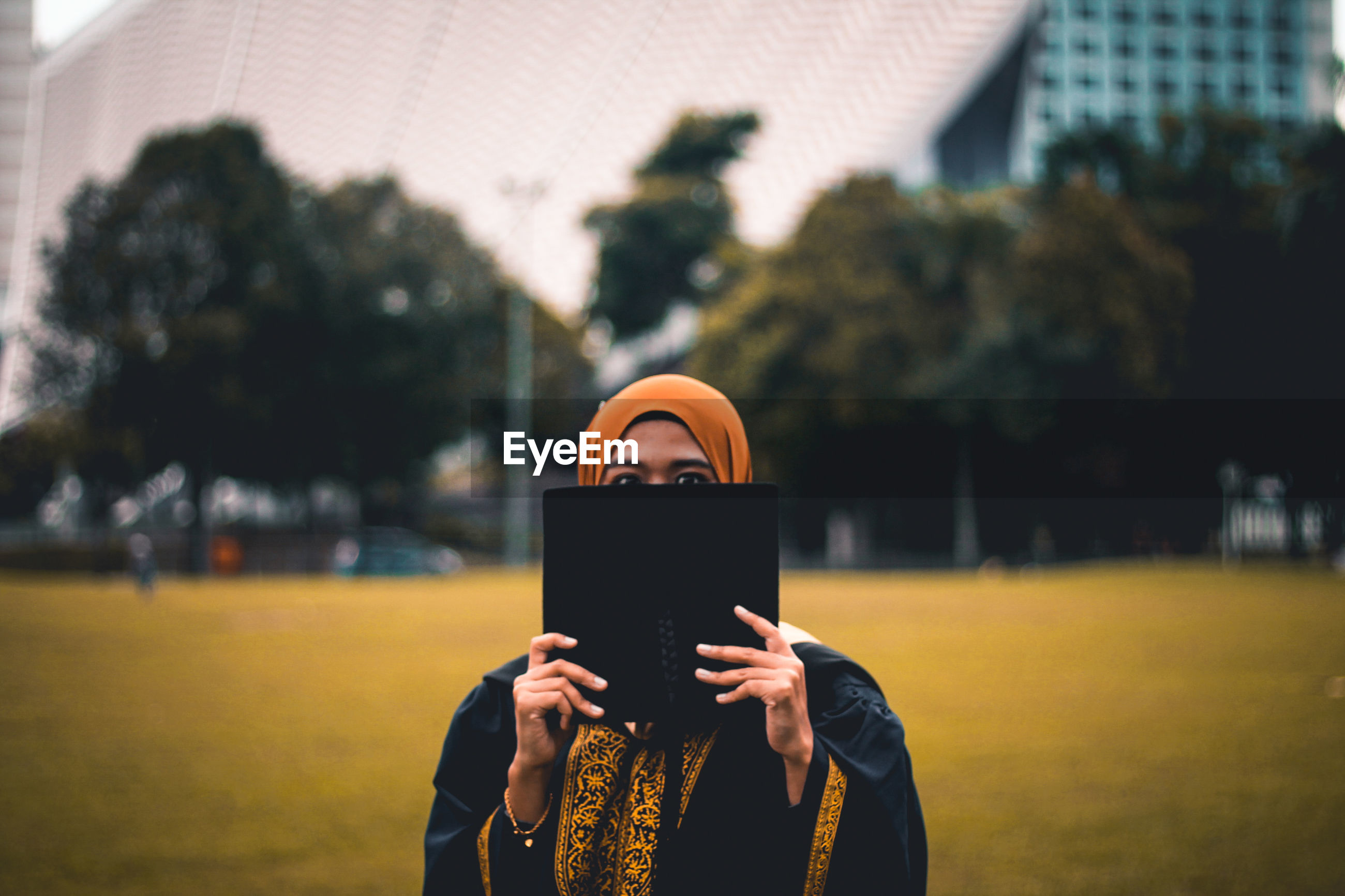 wireless technology, communication, technology, mobile phone, portable information device, smart phone, child, holding, human body part, lifestyles, one person, leisure activity, outdoors, city, real people, human hand, sunset, night, people, close-up, adult, nature, solar eclipse