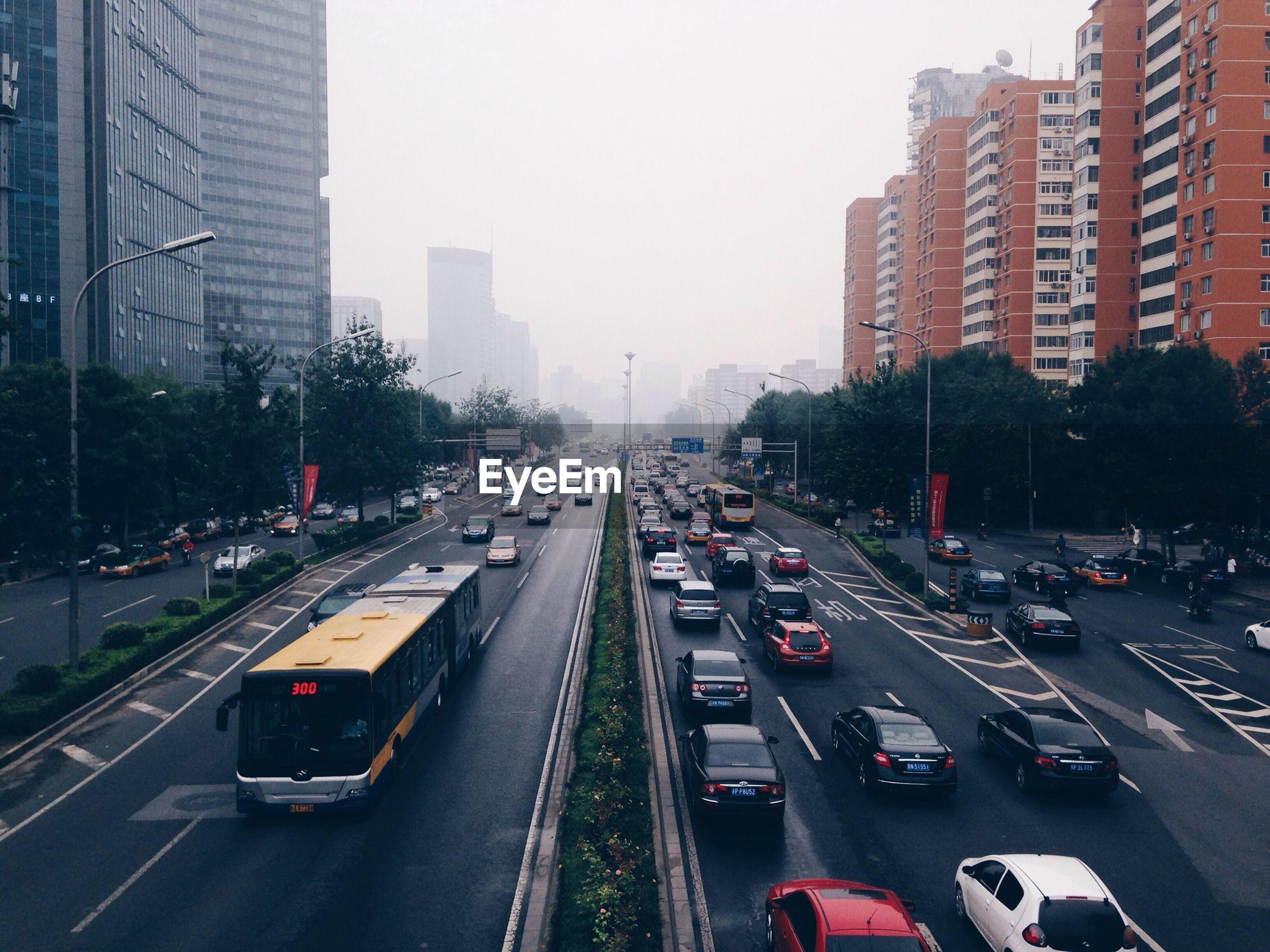 Busy city street between modern buildings