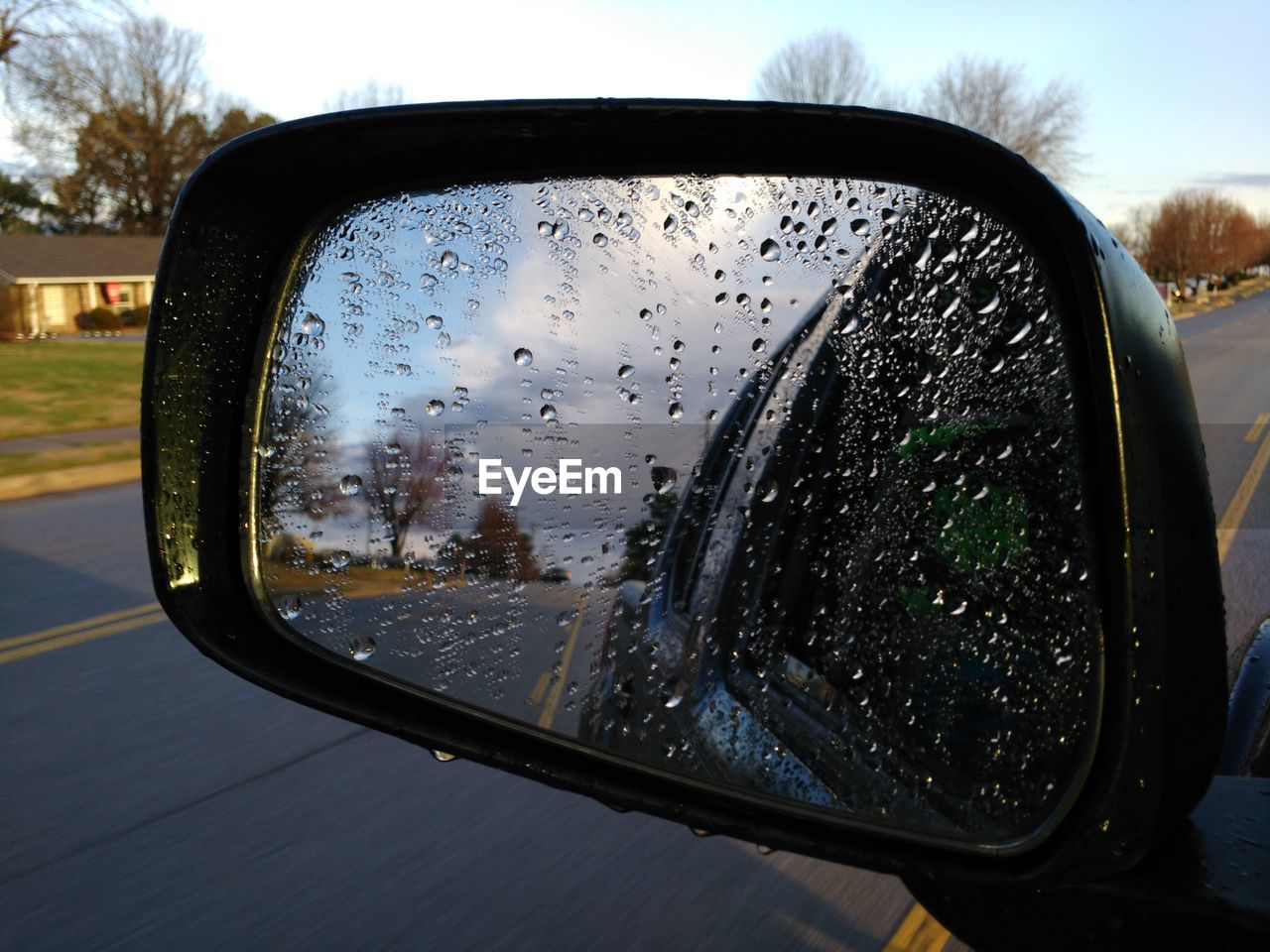 side-view mirror, car, transportation, glass - material, wet, mode of transport, land vehicle, window, drop, car interior, water, vehicle mirror, close-up, reflection, no people, road, day, focus on foreground, sky, nature, raindrop, vehicle part, tree, outdoors