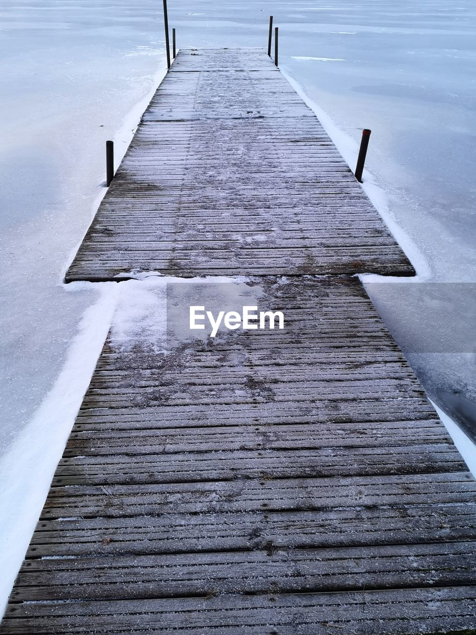 direction, the way forward, wood - material, snow, no people, day, cold temperature, winter, pier, water, nature, footpath, diminishing perspective, outdoors, boardwalk, architecture, built structure, frozen, wood, wood paneling, long, surface level
