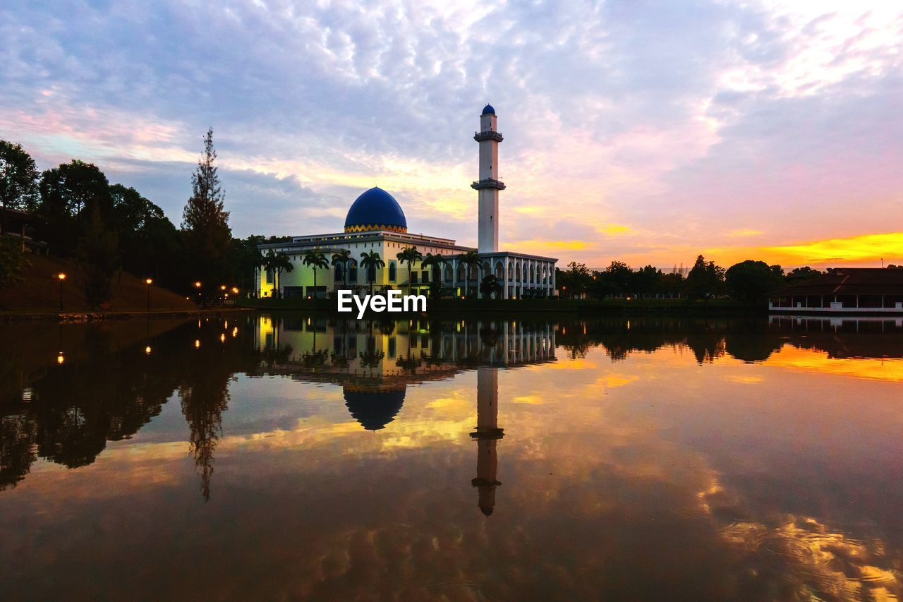 reflection, sky, architecture, built structure, building exterior, place of worship, religion, cloud - sky, dome, belief, spirituality, lake, water, waterfront, sunset, nature, tourism, no people, outdoors