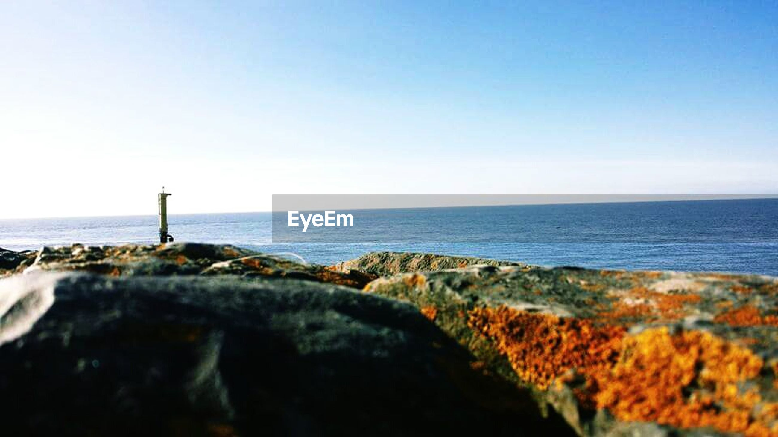 sea, horizon over water, water, nature, beauty in nature, rock - object, clear sky, scenics, sky, sunlight, tranquility, day, beach, outdoors, tranquil scene, no people