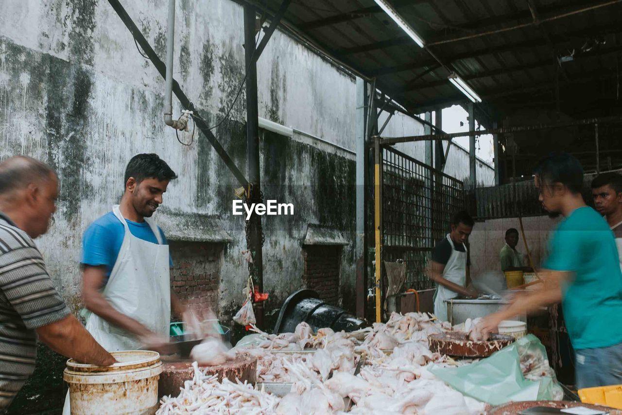 Men working at butcher shop