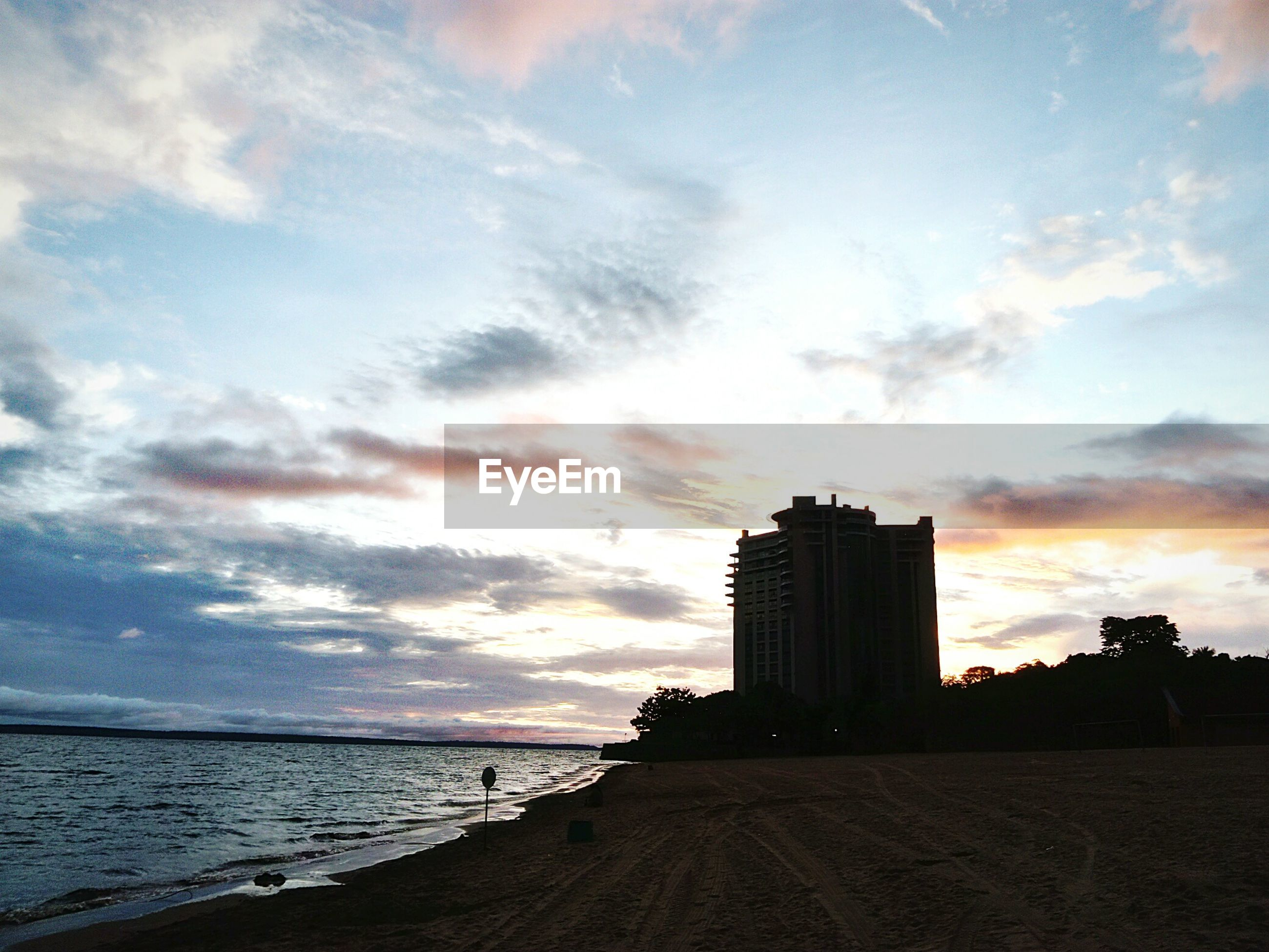 sky, cloud - sky, water, sea, beach, architecture, built structure, building exterior, nature, land, scenics - nature, beauty in nature, horizon over water, horizon, outdoors, no people, sunset, building, sand, office building exterior, skyscraper