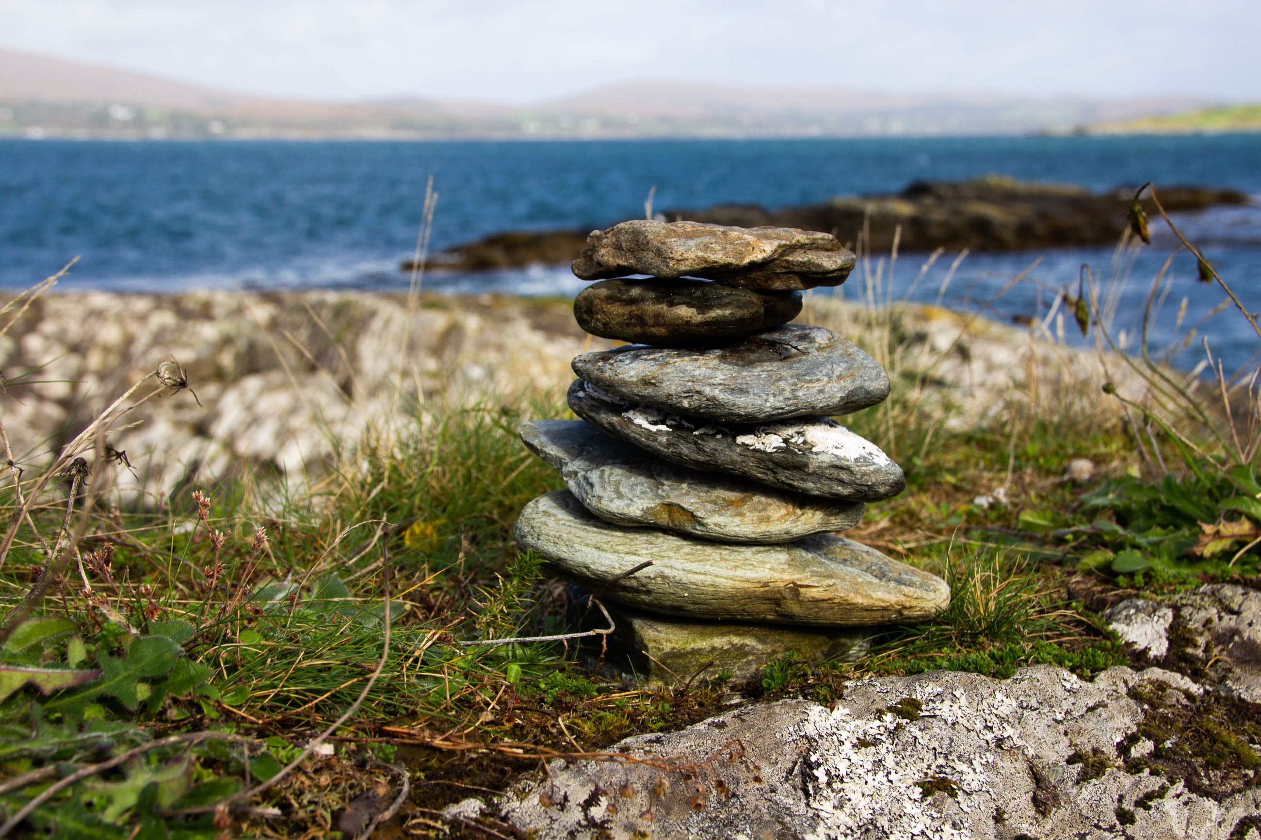 STACK OF ROCKS ON SHORE