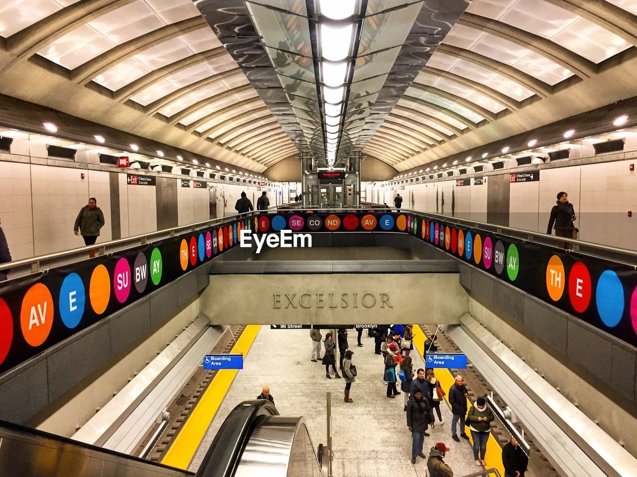 large group of people, public transportation, subway station, subway, real people, indoors, train - vehicle, transportation, passenger, men, rail transportation, illuminated, built structure, commuter, subway train, architecture, women, transportation building - type of building, travel, modern, lifestyles, technology, city, day, people, adult, adults only