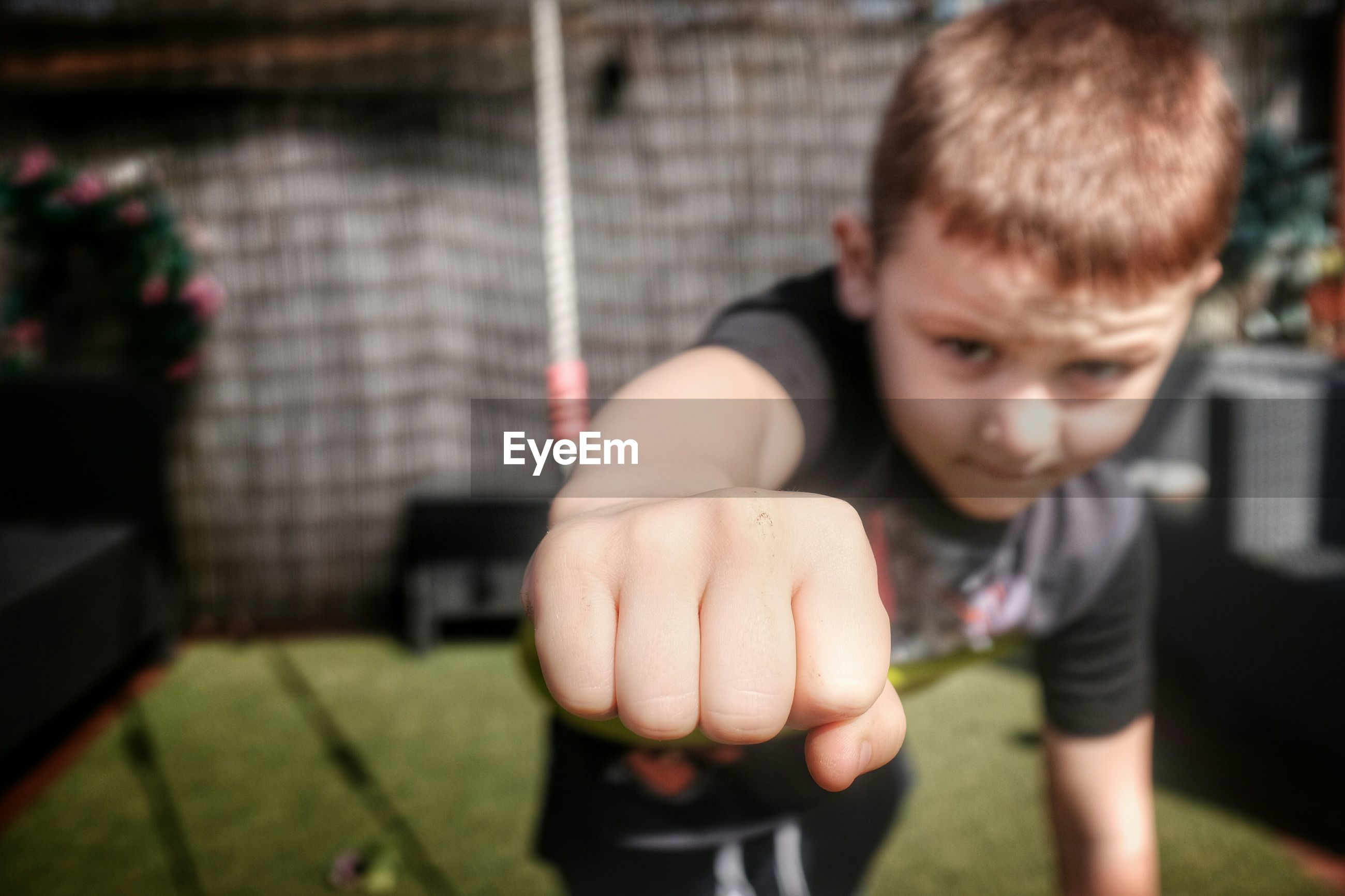 Portrait of boy showing fist