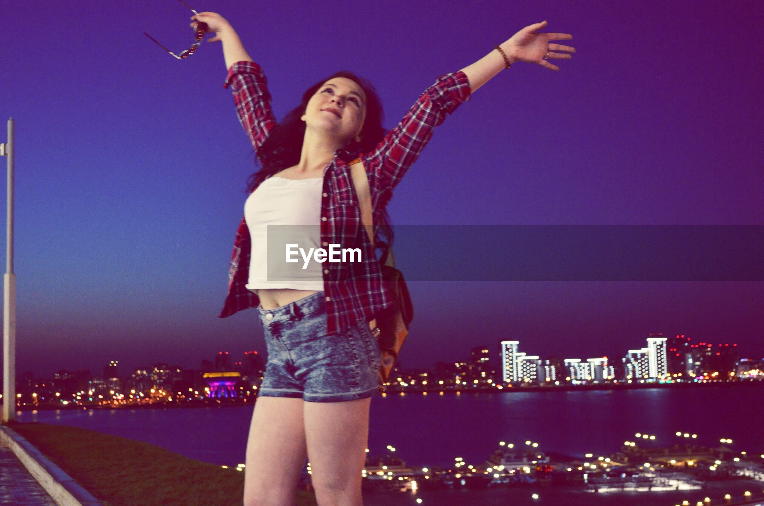 night, lifestyles, leisure activity, illuminated, arts culture and entertainment, casual clothing, city, blue, enjoyment, city life, fun, outdoors, cityscape, sky, tourism