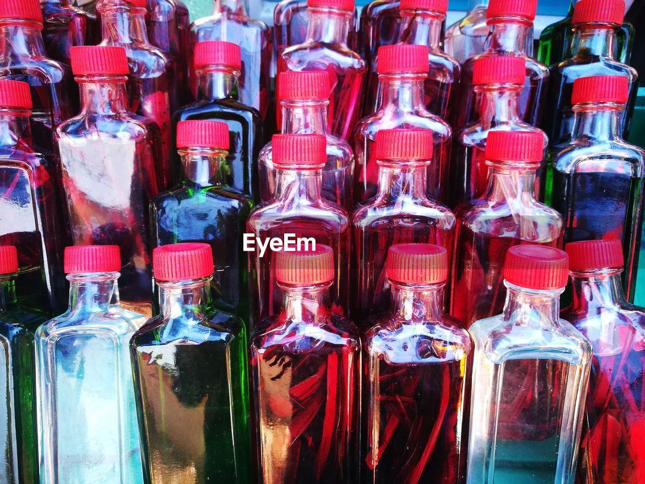 Full frame shot of glass bottles