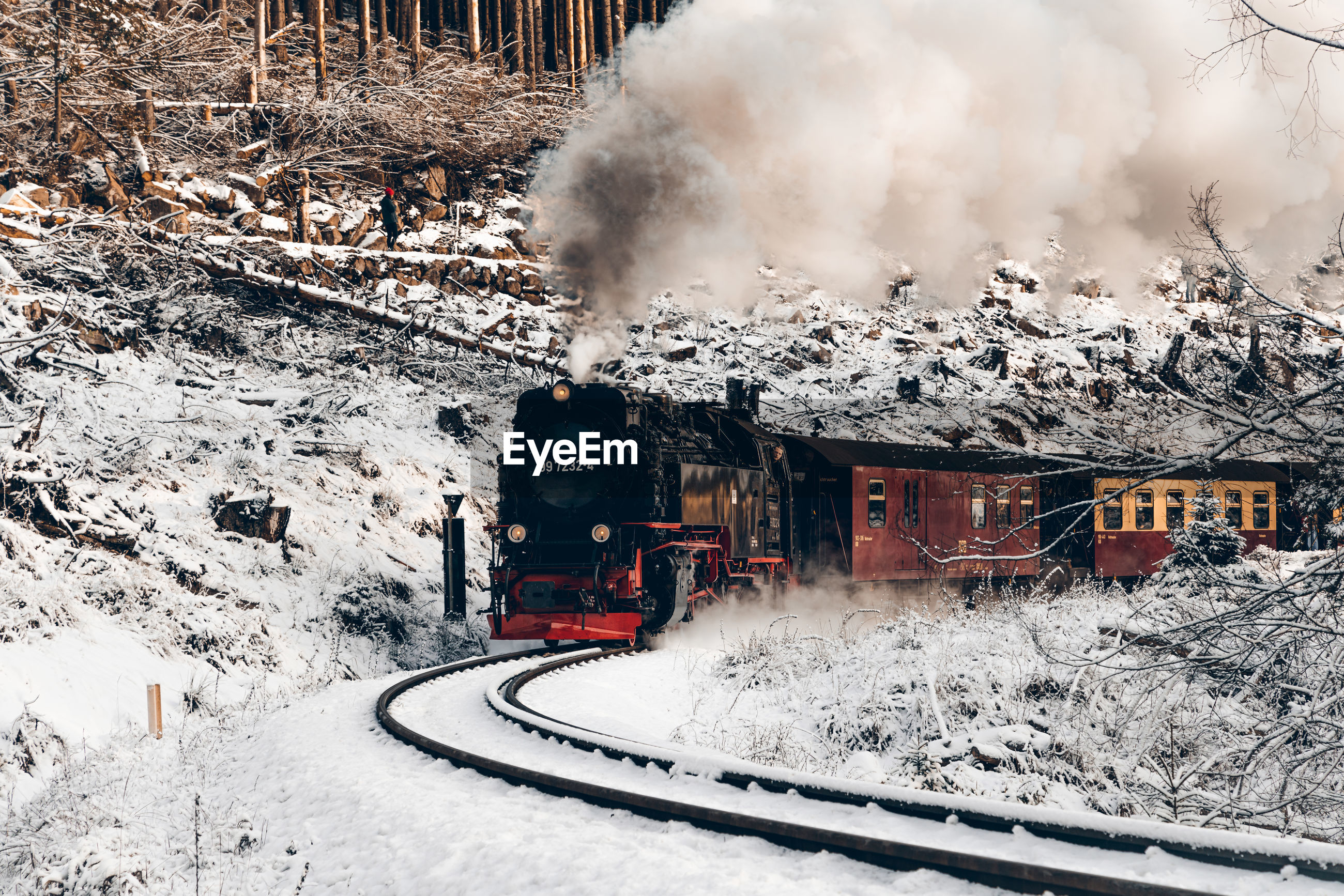 TRAIN ON SNOW COVERED RAILROAD TRACKS