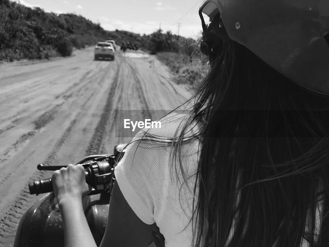 Rear view of woman riding motorcycle