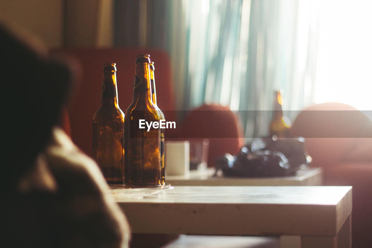 Beer bottles on table in room