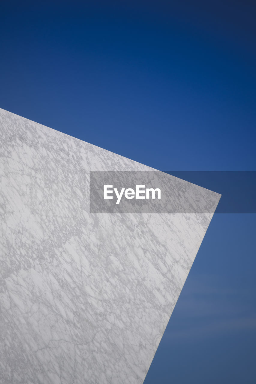 sky, blue, clear sky, copy space, low angle view, no people, nature, day, white color, outdoors, architecture, built structure, sunlight, building exterior, close-up, wall - building feature, geometric shape, white, wall, building, blank