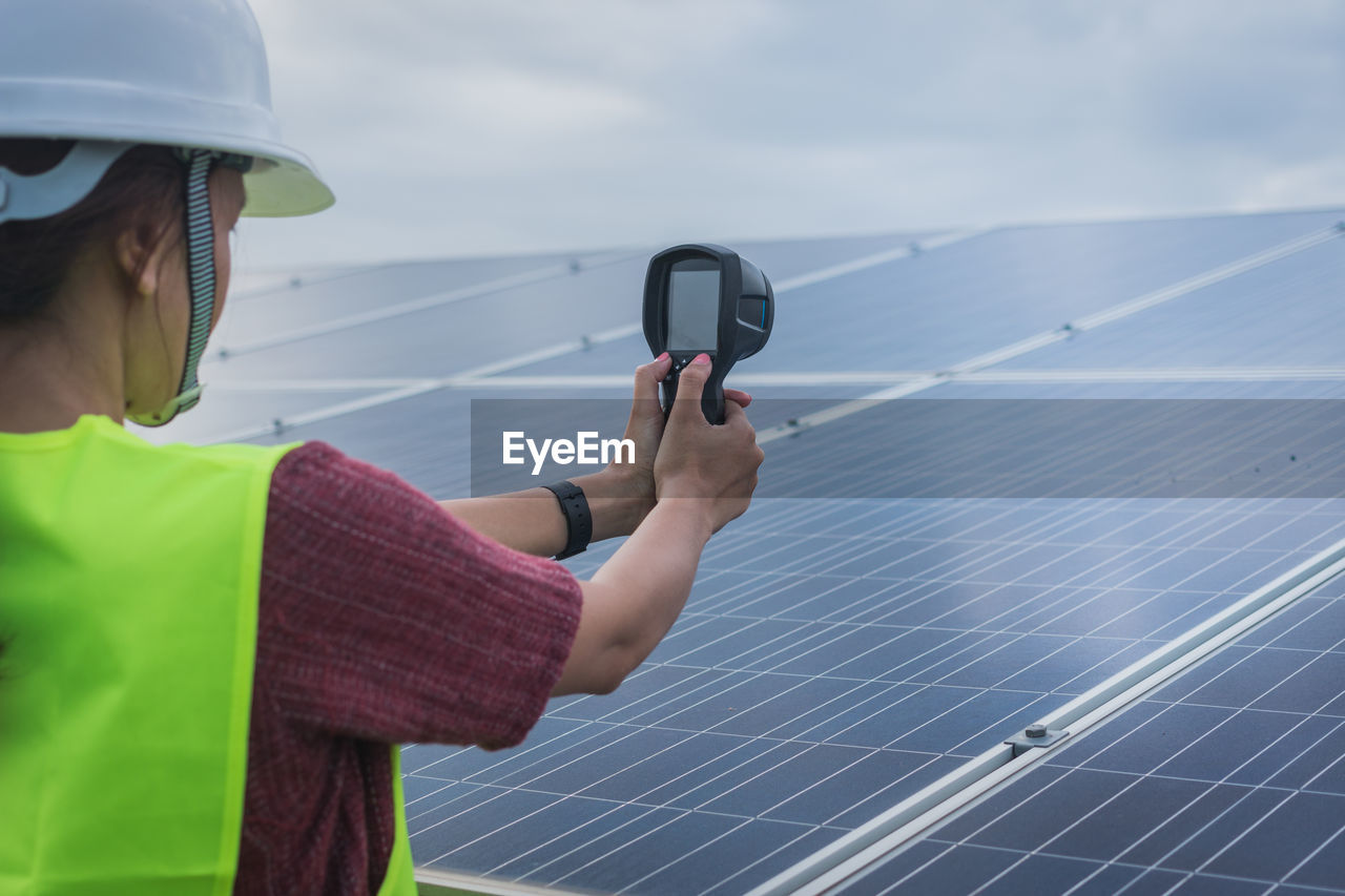 technology, fuel and power generation, environmental conservation, alternative energy, sky, solar energy, real people, renewable energy, one person, environment, solar panel, wireless technology, nature, communication, holding, headshot, adult, day, environmental issues, power supply, outdoors, electricity