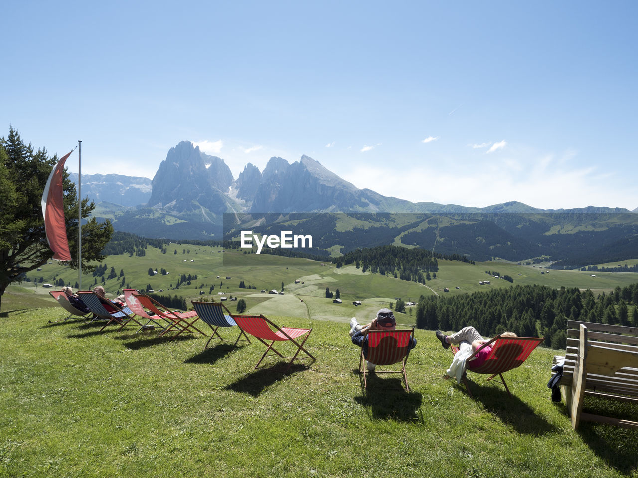 People Sitting On Folding Chairs While Looking At Mountains