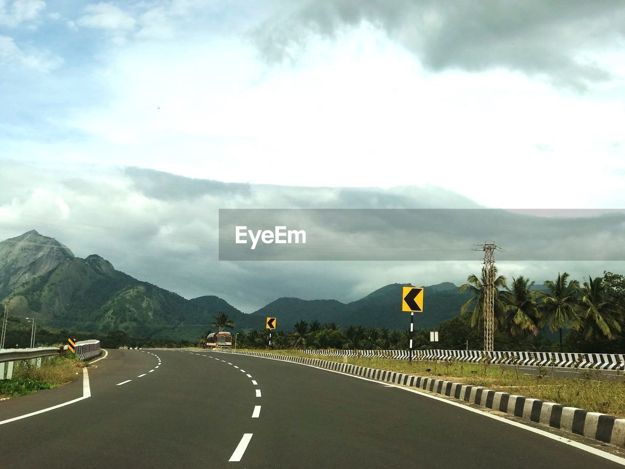 road, sky, mountain, the way forward, cloud - sky, transportation, day, outdoors, nature, scenics, landscape, mountain range, tree, beauty in nature, no people