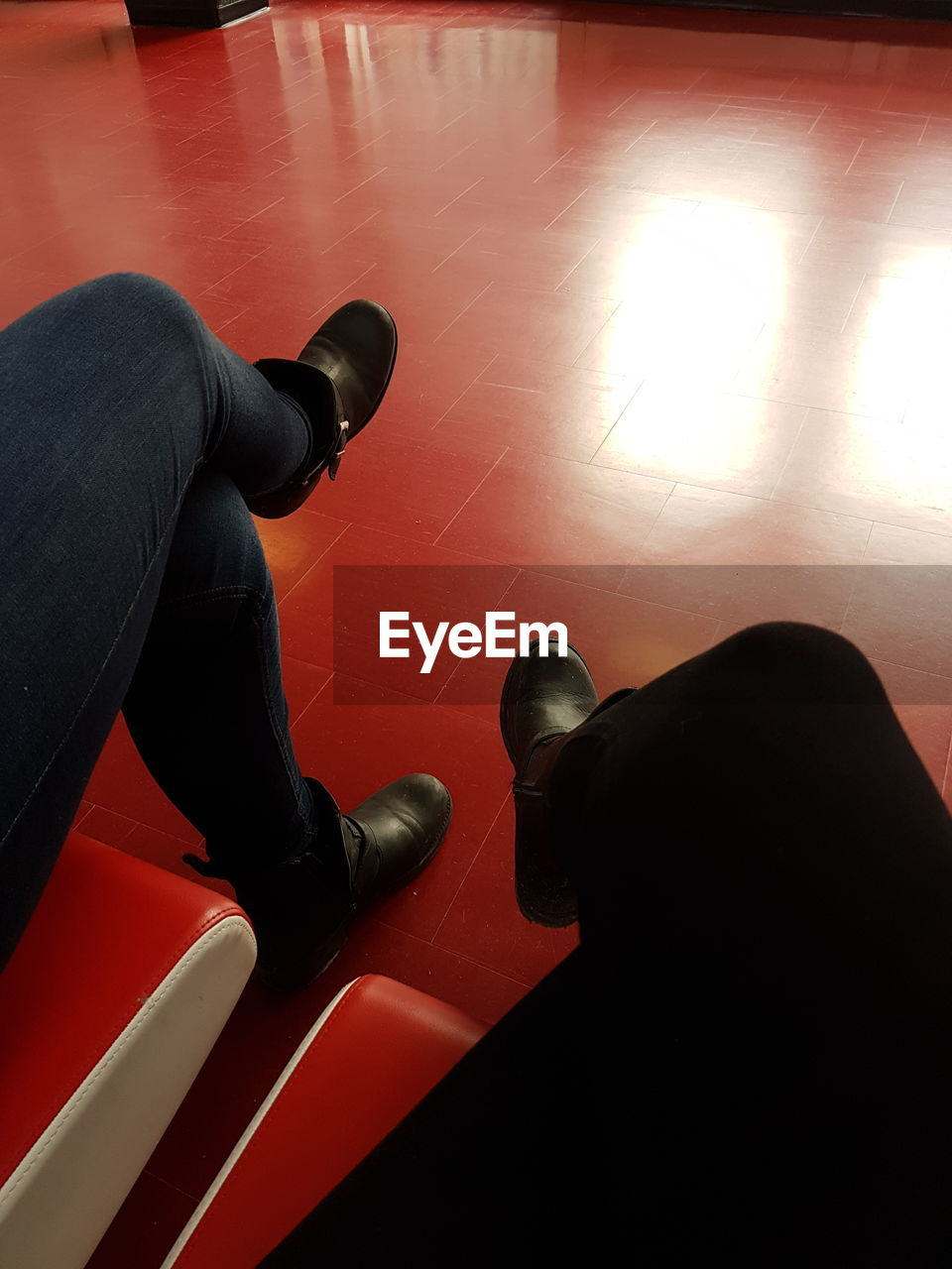 indoors, two people, high angle view, real people, shoe, men, relaxation, low section, sitting, human leg, togetherness, human body part, day, close-up, people