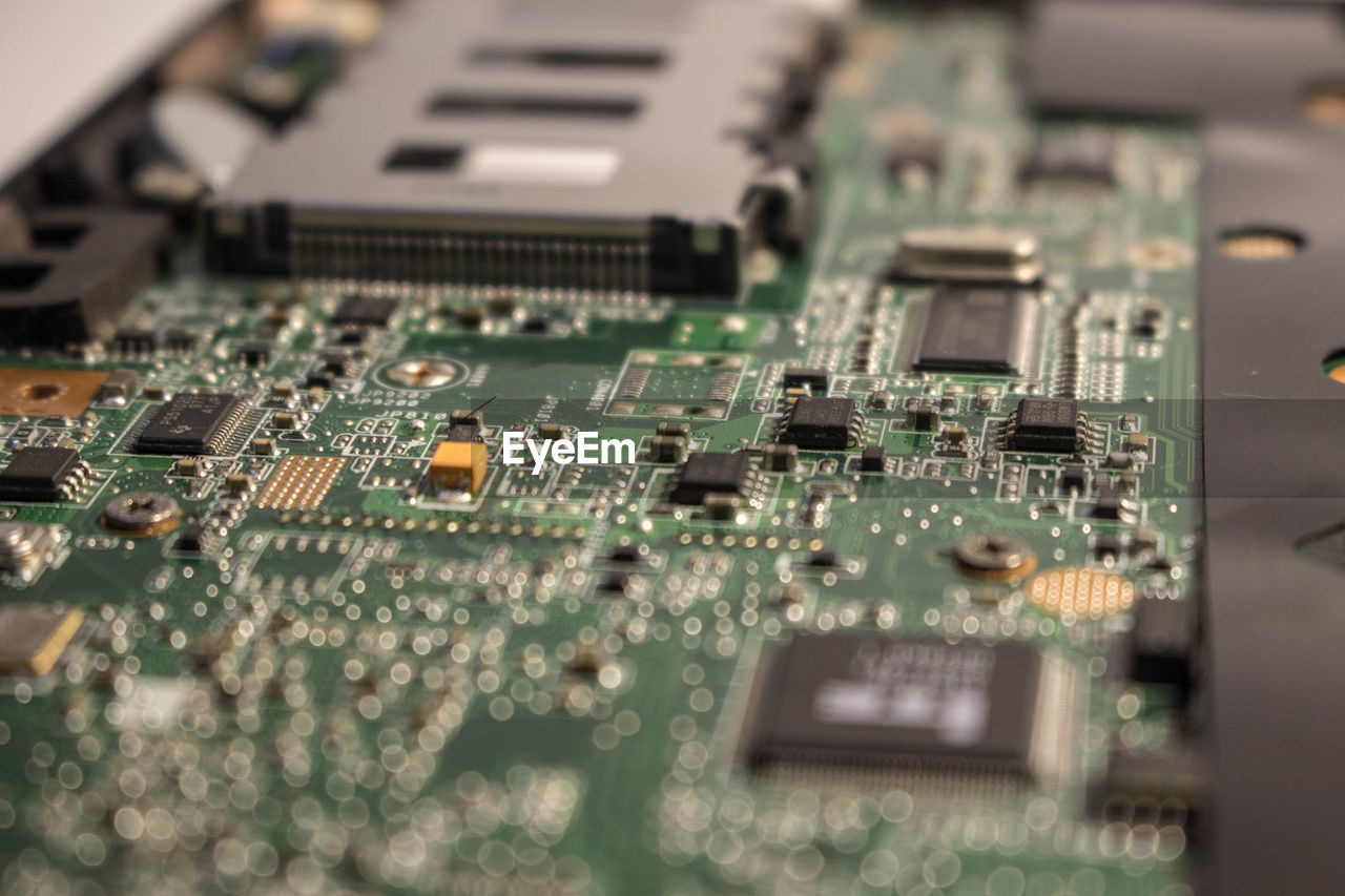 circuit board, computer chip, electronics industry, technology, computer equipment, industry, mother board, selective focus, equipment, no people, computer part, connection, complexity, close-up, computer, backgrounds, full frame, indoors, green color, communication, electrical component, electrical equipment