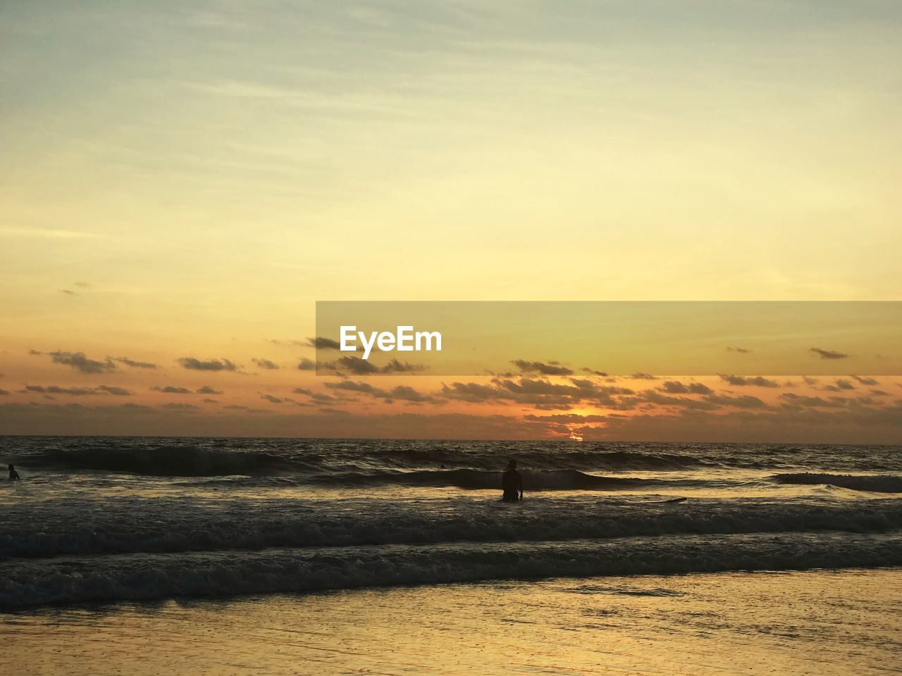sunset, sky, sea, water, beauty in nature, horizon over water, scenics - nature, orange color, horizon, land, cloud - sky, silhouette, beach, tranquility, nature, tranquil scene, motion, wave, outdoors