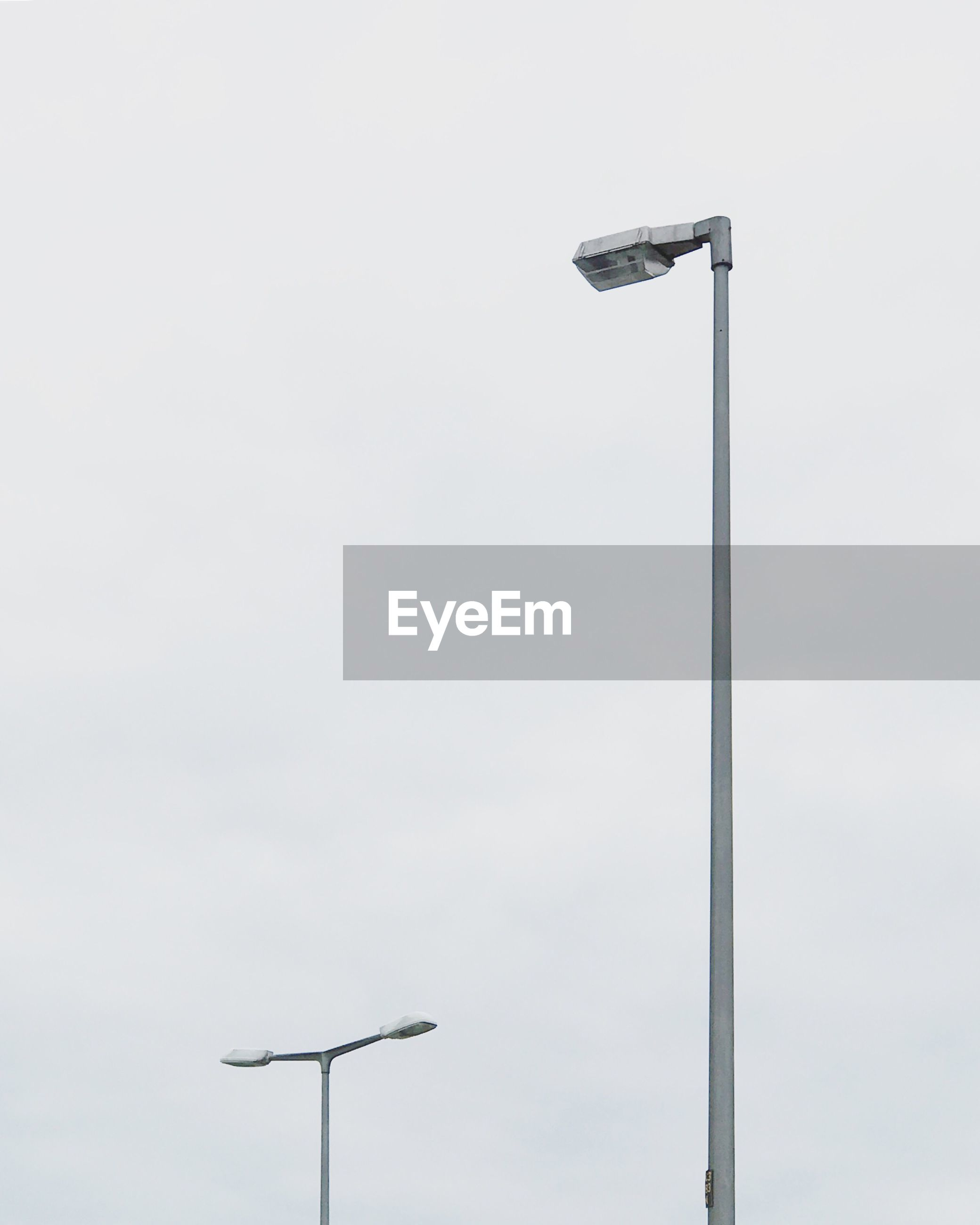 LOW ANGLE VIEW OF FLOODLIGHT AGAINST STREET LIGHT