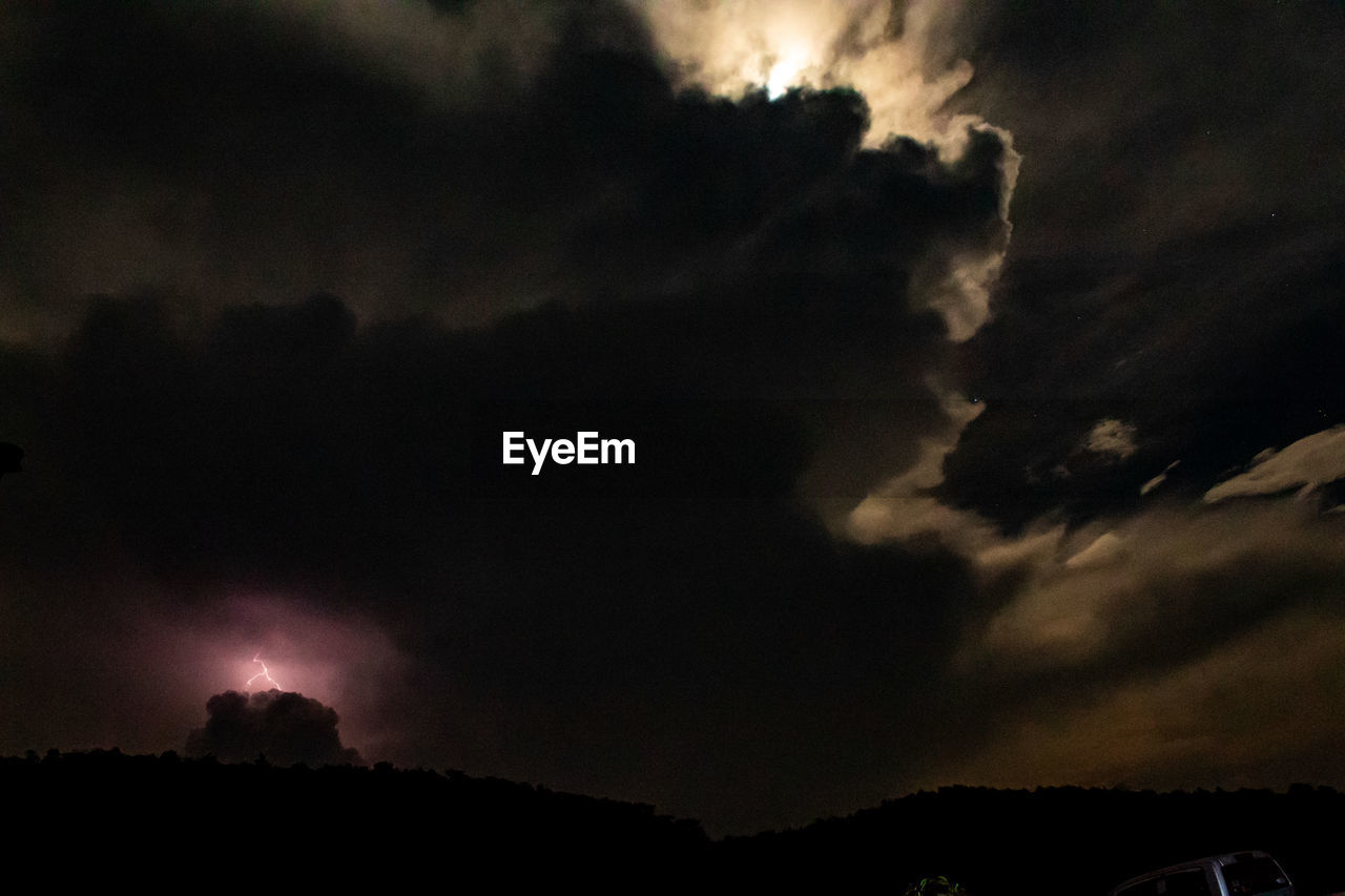 cloud - sky, sky, beauty in nature, storm, scenics - nature, nature, night, silhouette, storm cloud, environment, thunderstorm, no people, tranquil scene, overcast, tranquility, landscape, low angle view, dramatic sky, outdoors, power in nature, dark, ominous